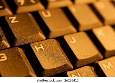 Detail of a computer keyboard in warm tone