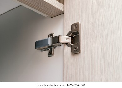 detail of concealed hinge on cabinet door, furniture fitting hardware for cupboard or wardrobe
