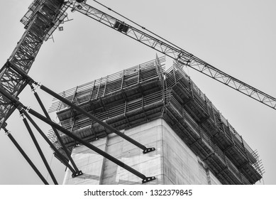 Detail of a construction site with crane in black and white colours