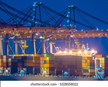 Detail of Container ship unloading at automated harbor terminal in Maasvlakte Europoort port of Rotterdam, Netherlands