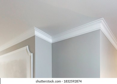 Detail of corner ceiling with intricate crown molding.