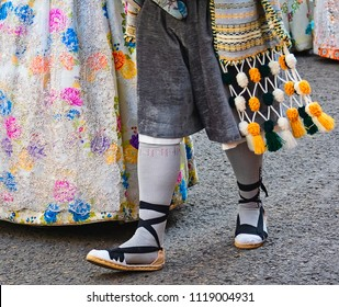 detail of the costumes of a woman faller and man fallero, in the party of the fallas of Valencia