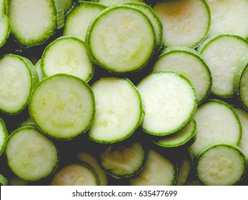 Detail of courgettes or zucchini vegetable food - useful as a background, vintage faded look
