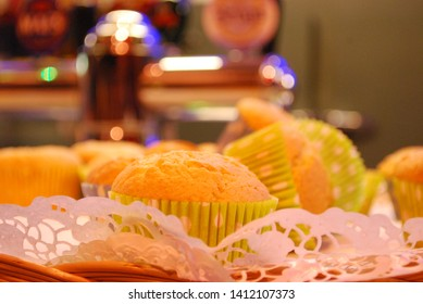 detail of cupcakes vanille flavor with green colorful wrapping with bokeh effect