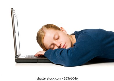 Detail of a cute blonde girl sleeping on her laptop computer, isolated on white background