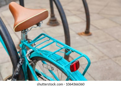 Detail of a cyan vintage bicycle in outdoor