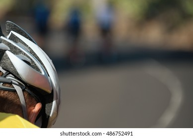 Detail cyclist helmet in the background three cyclists