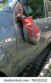 Detail of damaged mirror in gray van