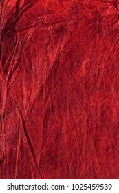 Detail of dark red paper background