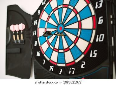 Detail of a dart bullseye with a nailed dart