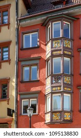 detail of decorated wooden bay-window on old house facade, shot in bright spring light at Rottweil, Baden Wuttenberg, Germany