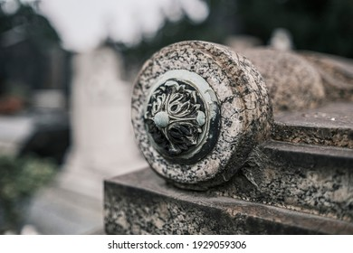 Detail of a decoration on the corner of a grave. High quality photo