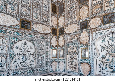 Detail of a decorative wall in the Mirror Palace at Amber Fort in Rajasthan, India,