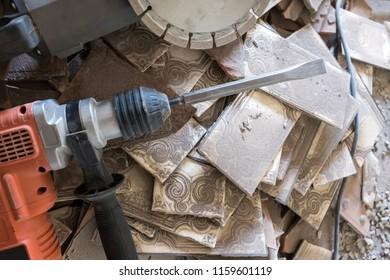 Detail of demolition equipment over a pile of broken pieces in demolition work