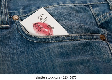 detail of a denim pocket holding a call me note