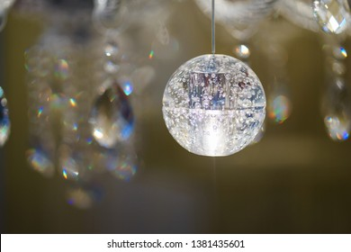 Detail design and interior lighting - white metal lamp. Extreme close-up on the elements of a stylish luxury chandelier. Soft focus and beautiful bokeh.