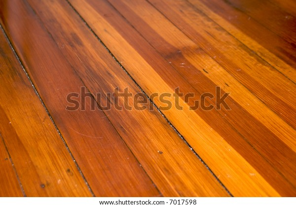 detail of dirty wooden pine floor in old new england suitable as a background
