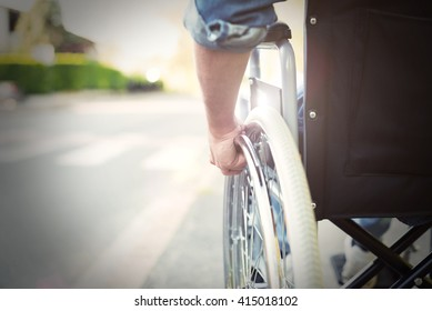 Detail of a disabled man on a wheelchair