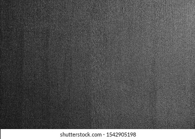 Detail of a door in graphite gray painted steel