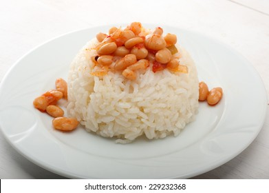 Detail of dried beans and pilaf plate