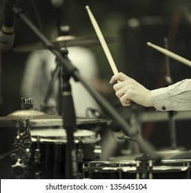 detail of a drummer on the rock concert, selective focus on hands