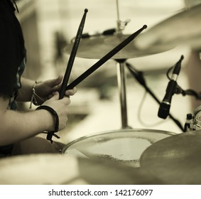 detail of a drummer on the rock concert