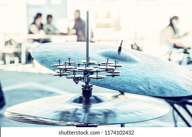 Detail of drums and cymbals. Concert scene with people. Blue photo filter.