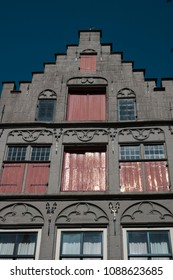 Detail Dutch house with stair step gable in Dordrecht, The Netherlands. Against blue sky