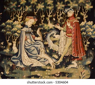 Detail of an early 15th century tapestry showing a man offering his heart to a lady