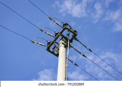 Detail of an electric pylon and the sky in the background