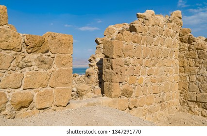 detail of the entrance of the ancient roman fortress that sits above the dead sea resort town of ein bokek in israel showing the pattern and texture of the stone walls