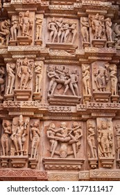 Detail from erotic carvings on the exterior of the 1,000 years old Kandariya Mahadev temple at Khajuraho, India