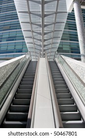 Detail of escalator stairs at a modern office building center - going up, going down