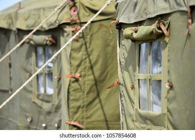 Detail with the exterior of a green military tent