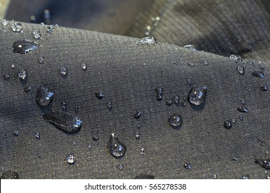detail of fabric water repellent, close up on an outdoor jacket material with water drops