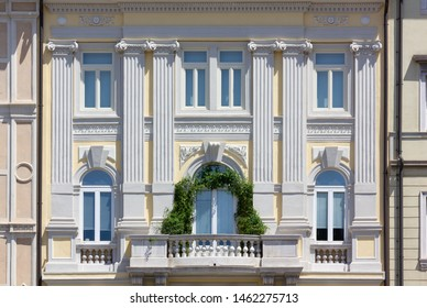 Detail of the facade of an elegant neoclassic historic building in Trieste, Italy