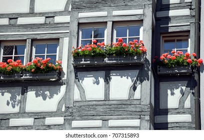 Detail of facade of half-timbered house in Germany with flowers