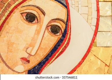 Detail of the face of a mosaic of the Blessed Virgin Mary with copy space for text