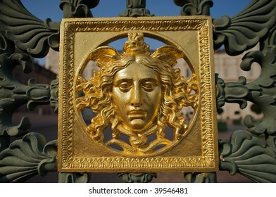 Detail of a face on the gate surrounding Royal Palace of Turin