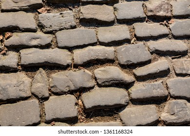 Detail of the famous cobblestone road Muur van Geraardsbergen located in Belgium. On this road every year is organized the famous one day road cycling race Tour of Flanders.