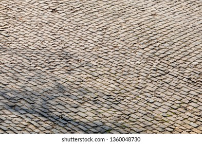 Detail of a famous crossroad on the cobblestone road Muur van Geraardsbergen located in Belgium. On this road every year is organized the famous one day road cycling race Tour of Flanders.