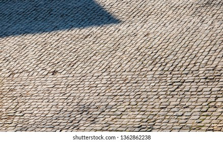 Detail of a famous crossroad on the cobblestone road Muur van Geraardsbergen, located in Belgium. On this road every year is organized the famous one day road cycling race Tour of Flanders.
