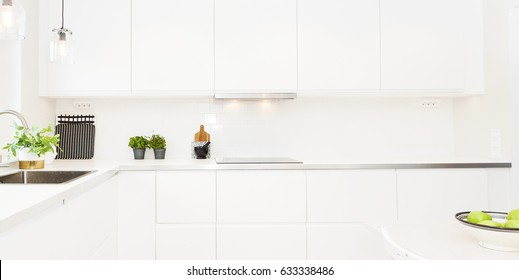 detail of a fancy kitchen counter top and cupboards panorama