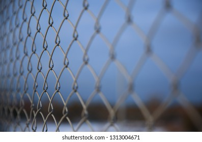 Detail of a fence with abstract background.