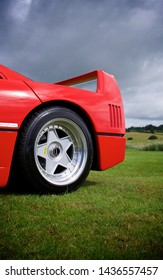Detail of a Ferrari F40 rear wheel and wing from low down - Newport, Wales - 16/06/2019