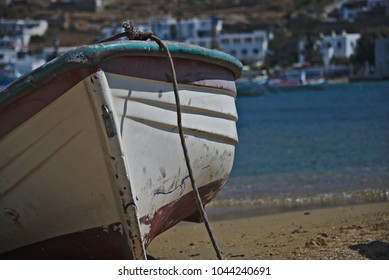 Detail of a fishing boat marooned on a beach.