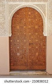 Detail form Alhambra palace in Granada, Andalusia - door made of carved wood