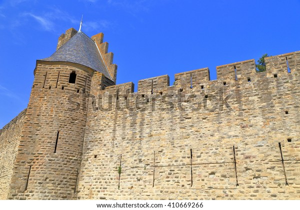 Detail of fortified towers and walls of the medieval town of Carcassonne, Languedoc-Roussillon, France