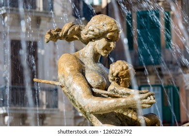 Detail of the fountain of goddess Diana, Archimede square (1907 by Giulio Moschetti) in downtown of Ortigia, Syracuse, Sicily island, Italy
