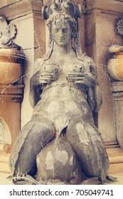 Detail Fountain of Neptune in Bologna. Italy. Piazza Maggiore